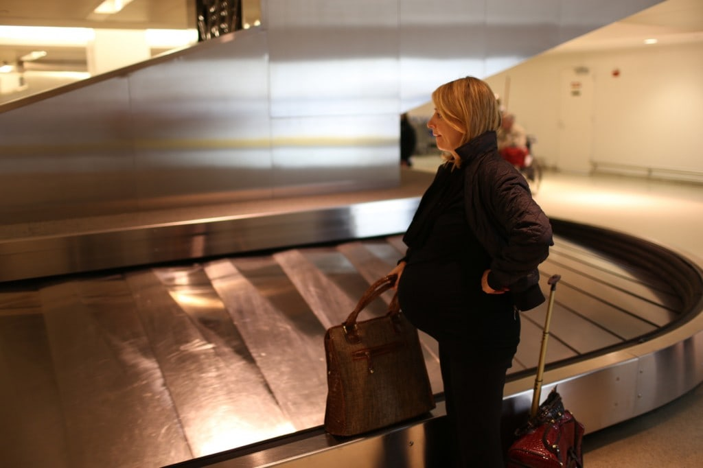 Samantha Brown waits for her luggage at the baggage claim