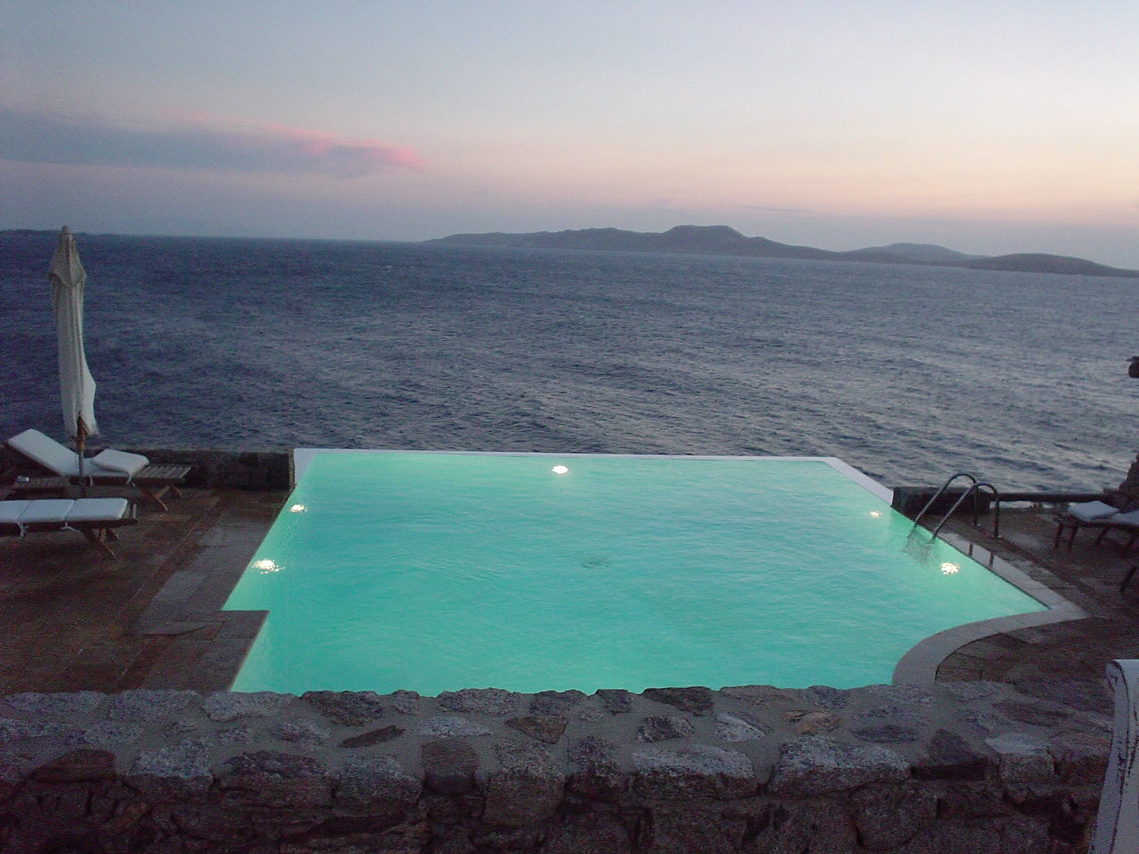 infinity pool sunset in greece samantha brown 39 s places to love. Black Bedroom Furniture Sets. Home Design Ideas